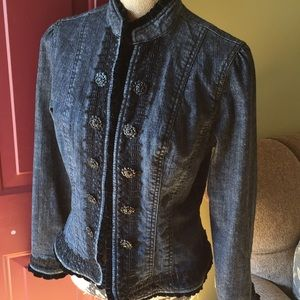Beautiful jean jacket with lots of decoration.